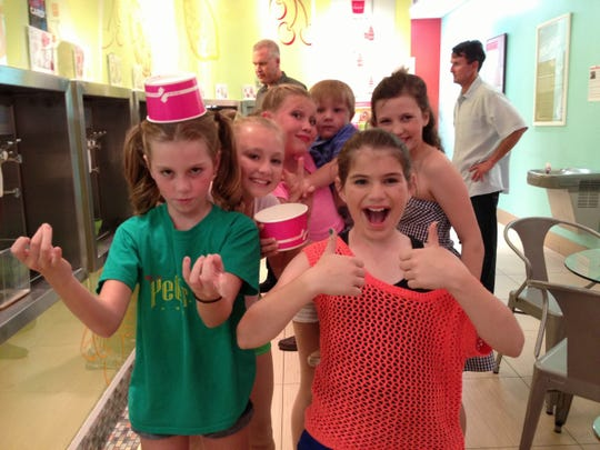 2013 photo of the StarStruck Theatre friends, left to right: Emma (with cup on head), Kaleigh, Jillian, (holding Kaleigh's little brother), Eliza (black and white check top) and Charlotte in front with thumbs up.