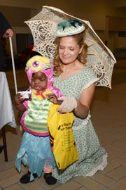 Occupational therapist Martha Taylor helps A'miyah trick or treat at the Halloween party at PATCHES Prescribed Pediatric Extended Care facility in Fort Pierce.