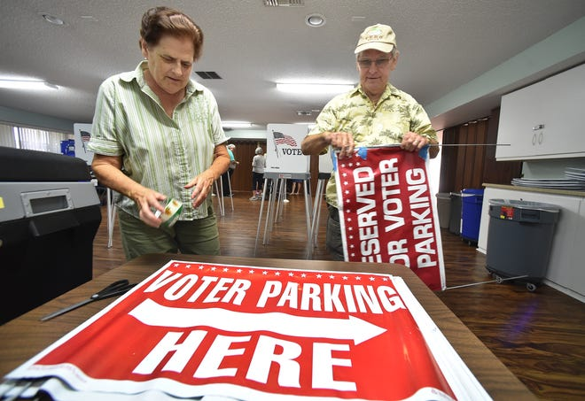 "Poll workers Carolyn Berzinski (left) and her husband Phil, of Vero Beach, make repairs to signs for precinct 27 at the Royal Palm Clubhouse, 400 Woodland Drive in the Vista Royale community on Monday, Nov. 5, 2018, in preparation for the Tuesday mid-term election in Indian River County. ""So you can put the right person to take care of the country, and the state,"" Carolyn Berzinski said about the importance of voting. ""Civic Opportunity,"" Phil Berzinski said. ""I would like to contribute, help out as much as I can, get people motivated to vote."""
