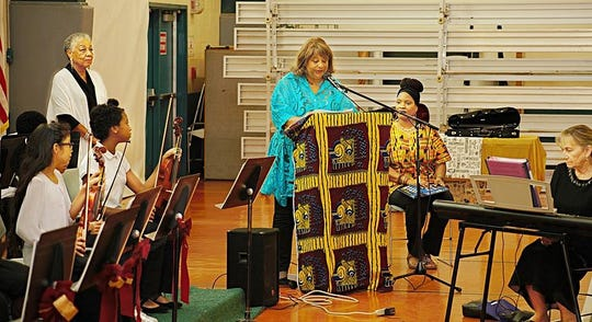 The Rev. Dr. Crystal Bujol, left, listens as Dr. Elaine Word welcomes the audience to the Gifford Youth Orchestra's 15th anniversary concert on Nov. 3. Also pictured are Iva Powell-Perry, seated, and Joan Haar, at keyboard.