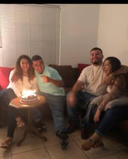 Jesus Jimenez (second from left) with friends and family. On Saturday the teen was fatally shot, deputies said.