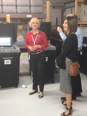 Vicki Davis, Martin County supervisor of elections, speaks with James Carroll and Angela Hoffman at the recent Logic and Accuracy test, a public analysis to ensure proper functionality of voting equipment.