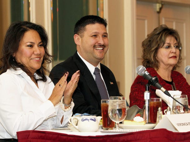 County Judge Veronica Escobar claps during a welcome at a candidates forum.