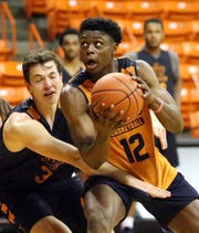 UTEP Junior transfer Anthony Tarke, 12, drives to the basket during Monday's practice in the Don Haskins Center.