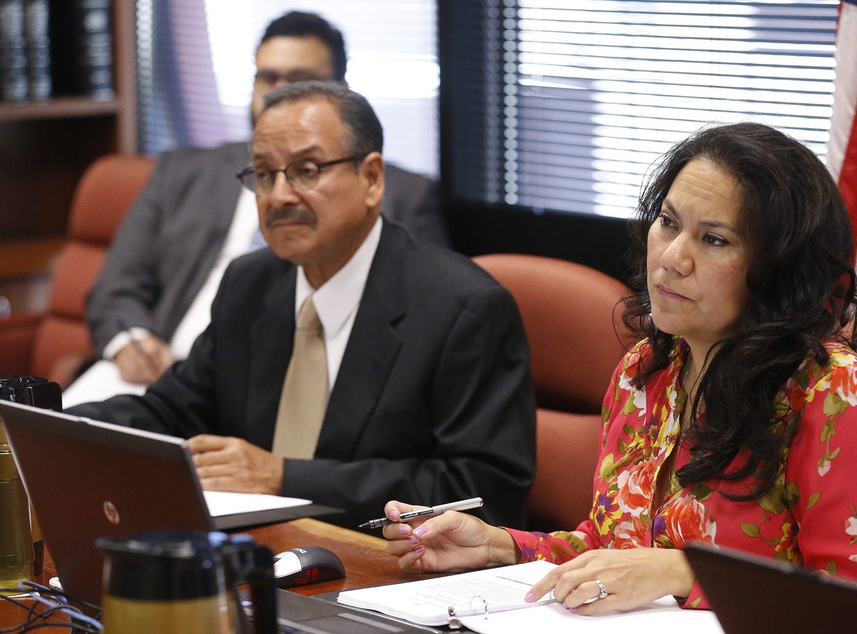 County Judge Veronica Escobar and Commissioner Carlos Leon listen in as a presentation is made by a county department head.