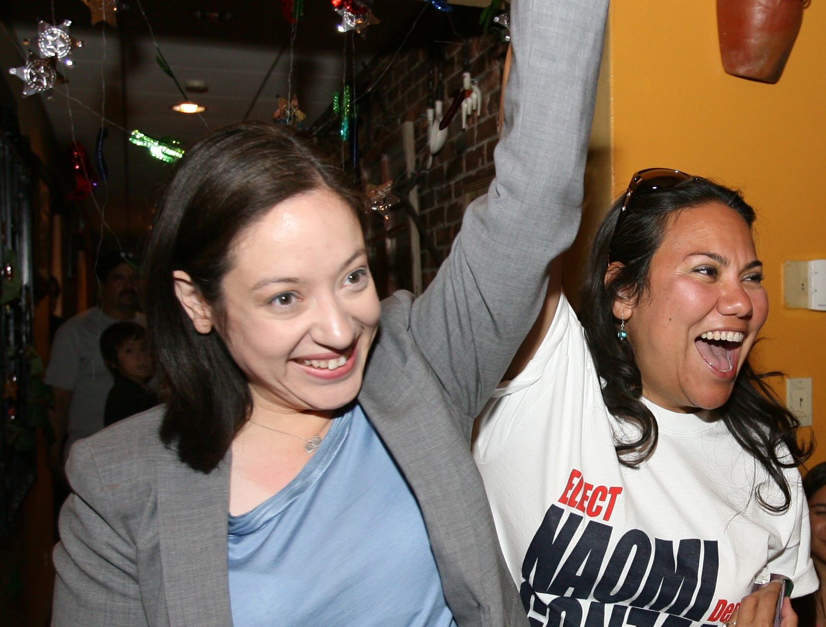 Naomi Gonzalezí arm is raised in victory by County Commissioner Veronica Escobar upon hearing she had defeated incumbent Norma Ch·vez in the primary runoff for state representative of District 76.