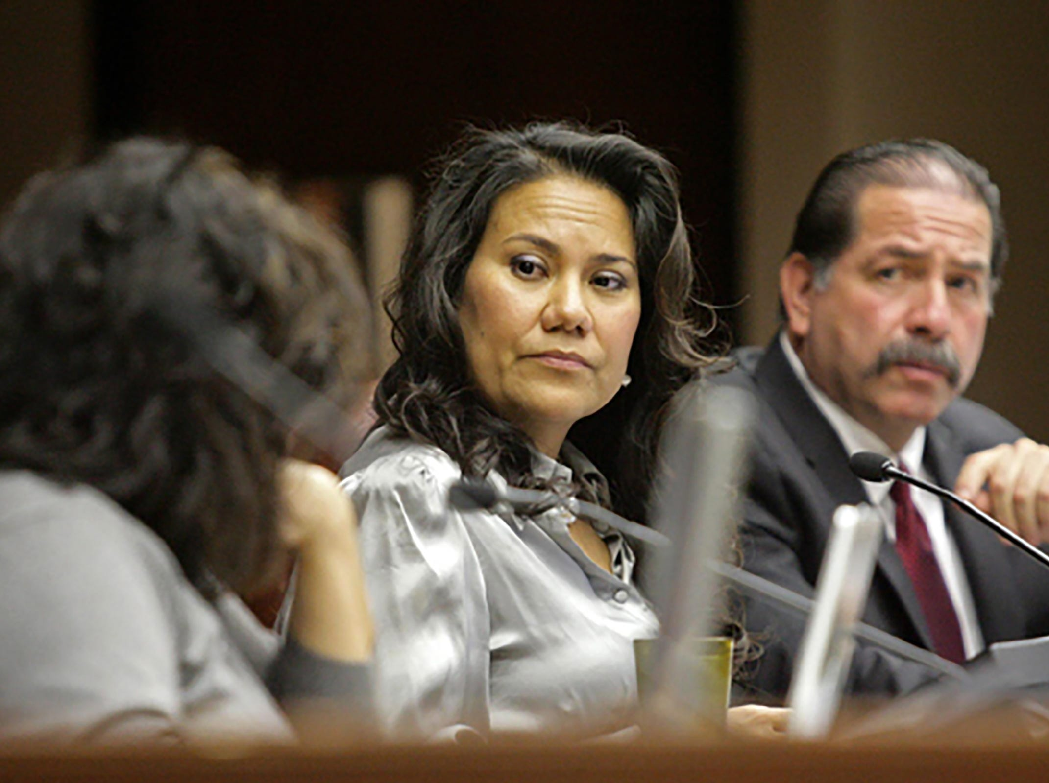 County Judge Veronica Escobar discusses the possible raising of taxes for the fiscal year that starts in October, with commissioner Anna Perez as commissioner Sergio Lewis listens on, to cover the shortfall for the El Paso County Hospital District. CEO Jim Valenti told commissioners court the hospital district has not raised taxes for operations in the past five years.