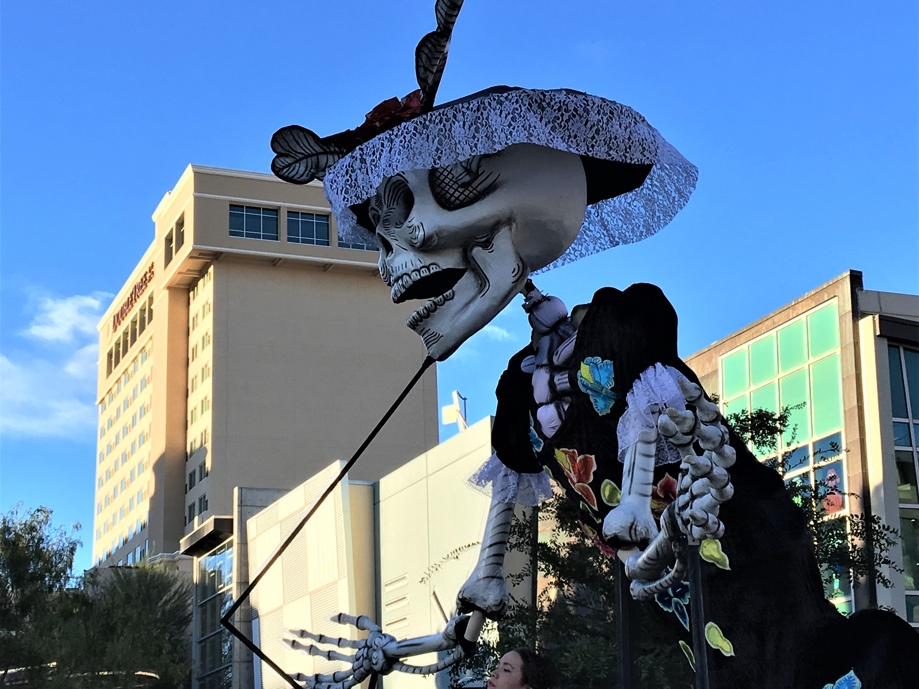A giant catrina marionette makes its way on Franklin Avenue during the Dia de los Muertos 2018 parade in Downtown El Paso.