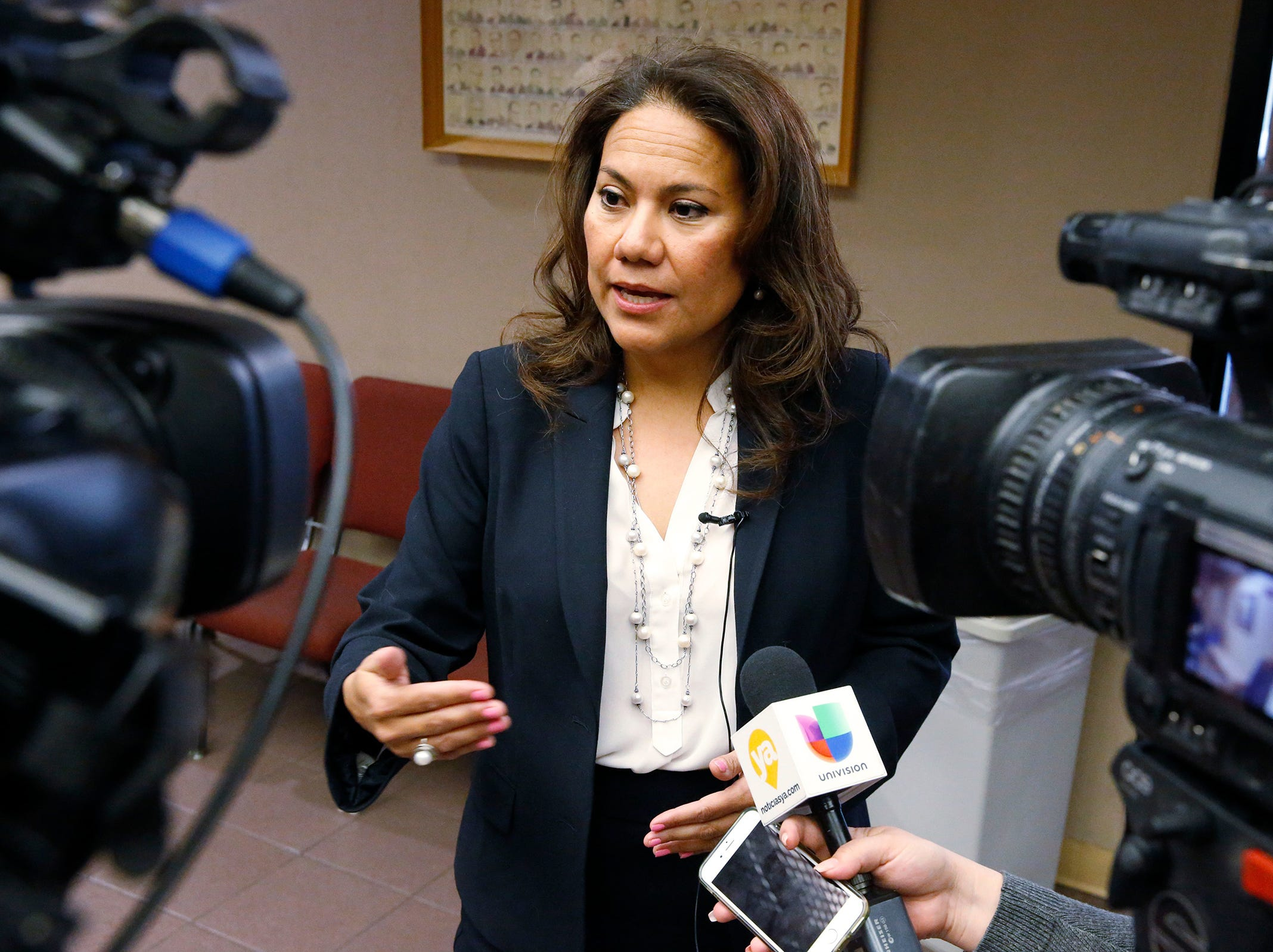 Former El Paso County Judge Veronica Escobar during a break of a county commisioners meeting answers questions from the media on oneof the agenda items.