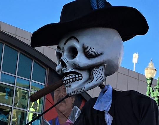 A giant skeleton marionette was part of the Dia de los Muertos parade Saturday in Downtown El Paso.