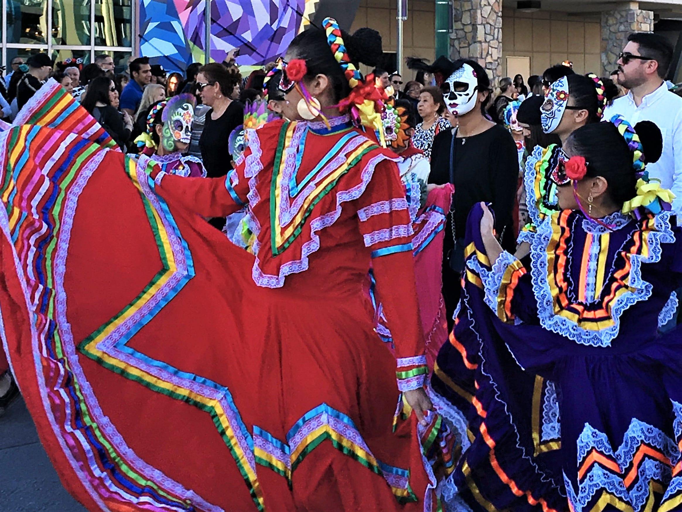 Masked folklorico dancers perform at the Dia de los Muertos 2018 parade in El Paso.