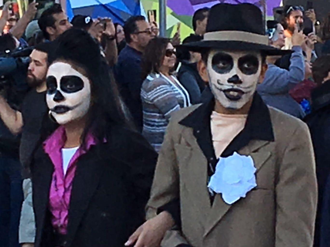 Dia de los Muertos-style pachucos in zoot suits walk in the Noche de Calaveras Parade in Downtown El Paso.