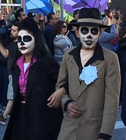 Dia de los Muertos-style pachucos in zoot suits walk in the Noche de Calaveras Parade in Downtown El Paso.