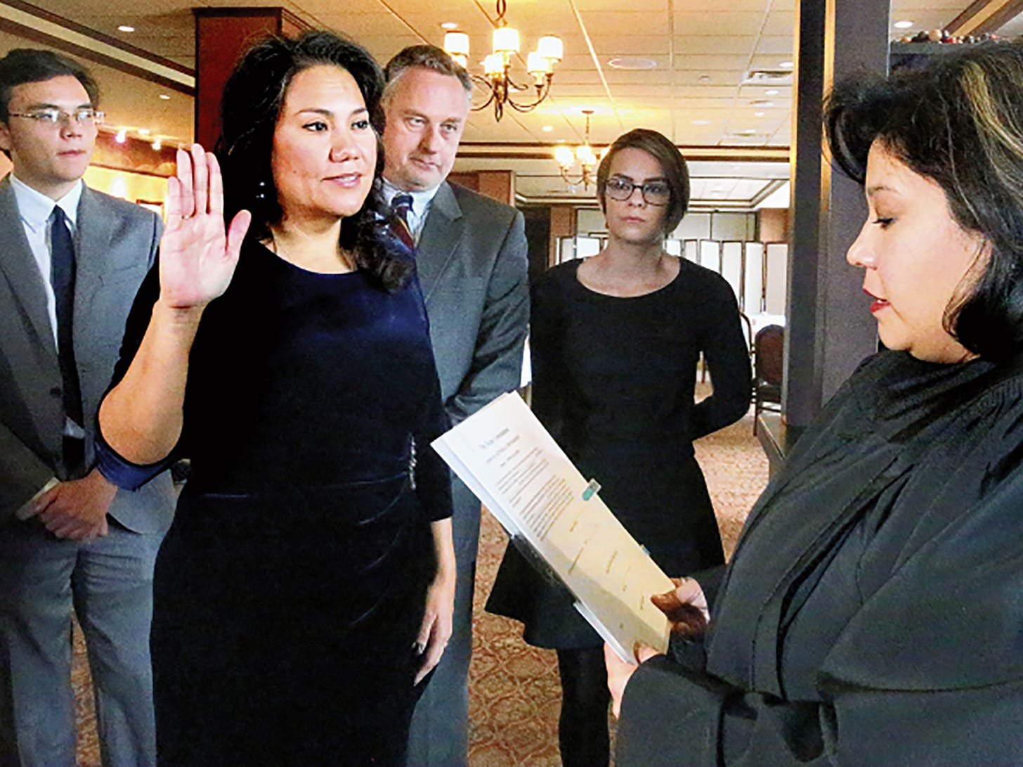 With her family by her side County Judge Veronica Escobas gets sworn in by District Judge Anna Perez after winning reelction.