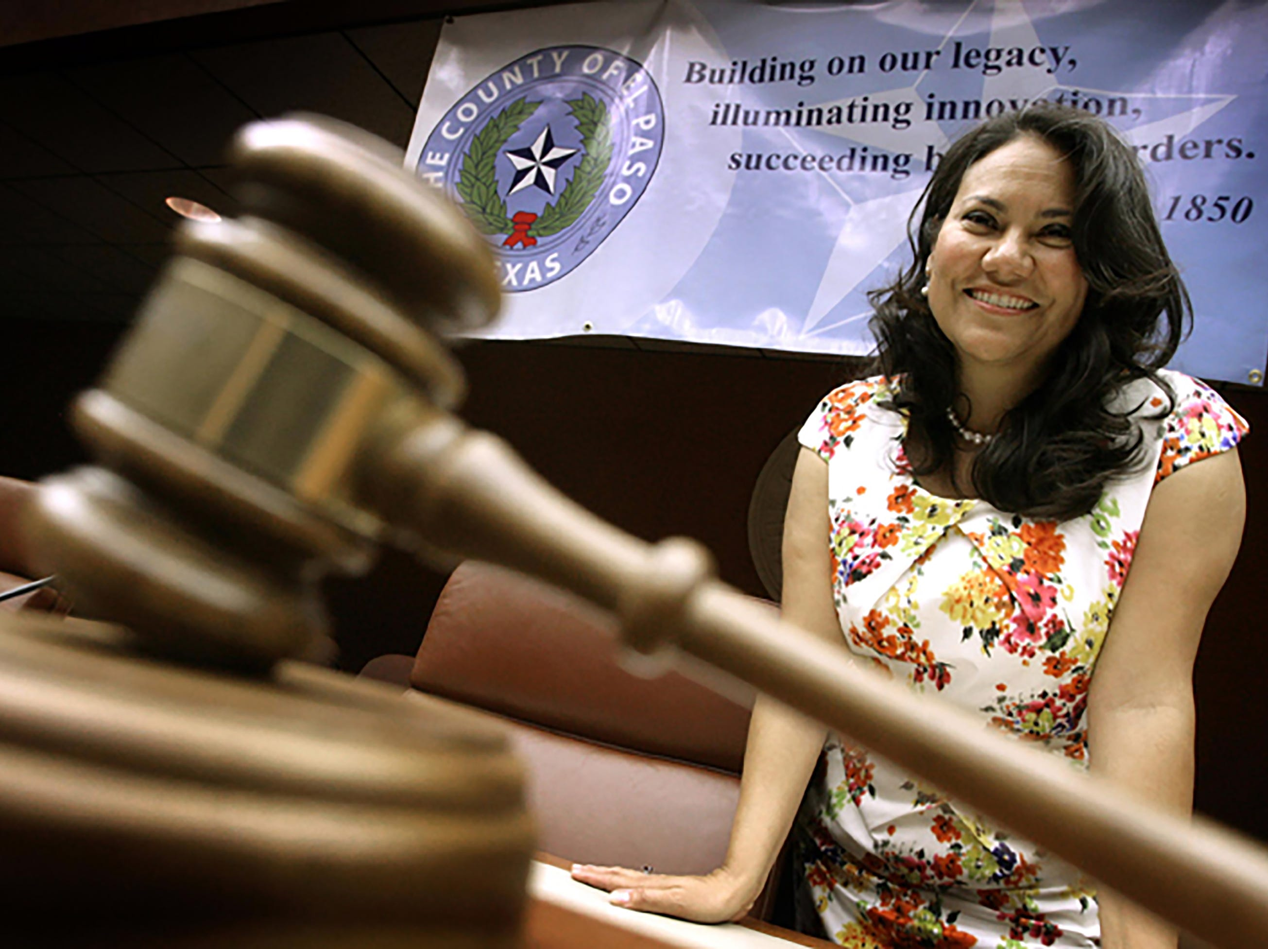 El Paso County Judge Veronica Escobar had a banner hung over commissioner's court with their new mission statement.