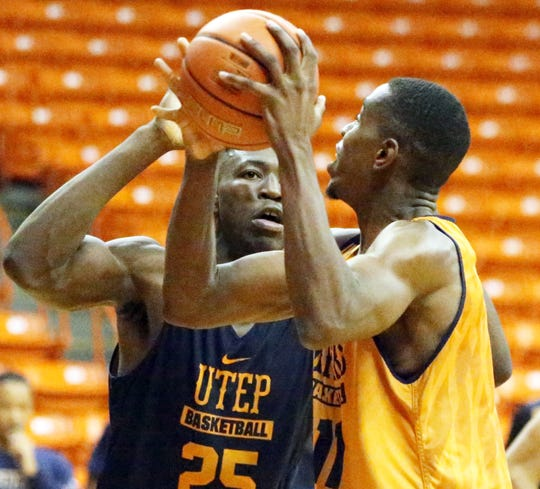 UTEP forward Kaosi Ezeagu, 25, defends against teammate Bryson Williams, 11, during Monday's practice in the Don Haskins Center.
