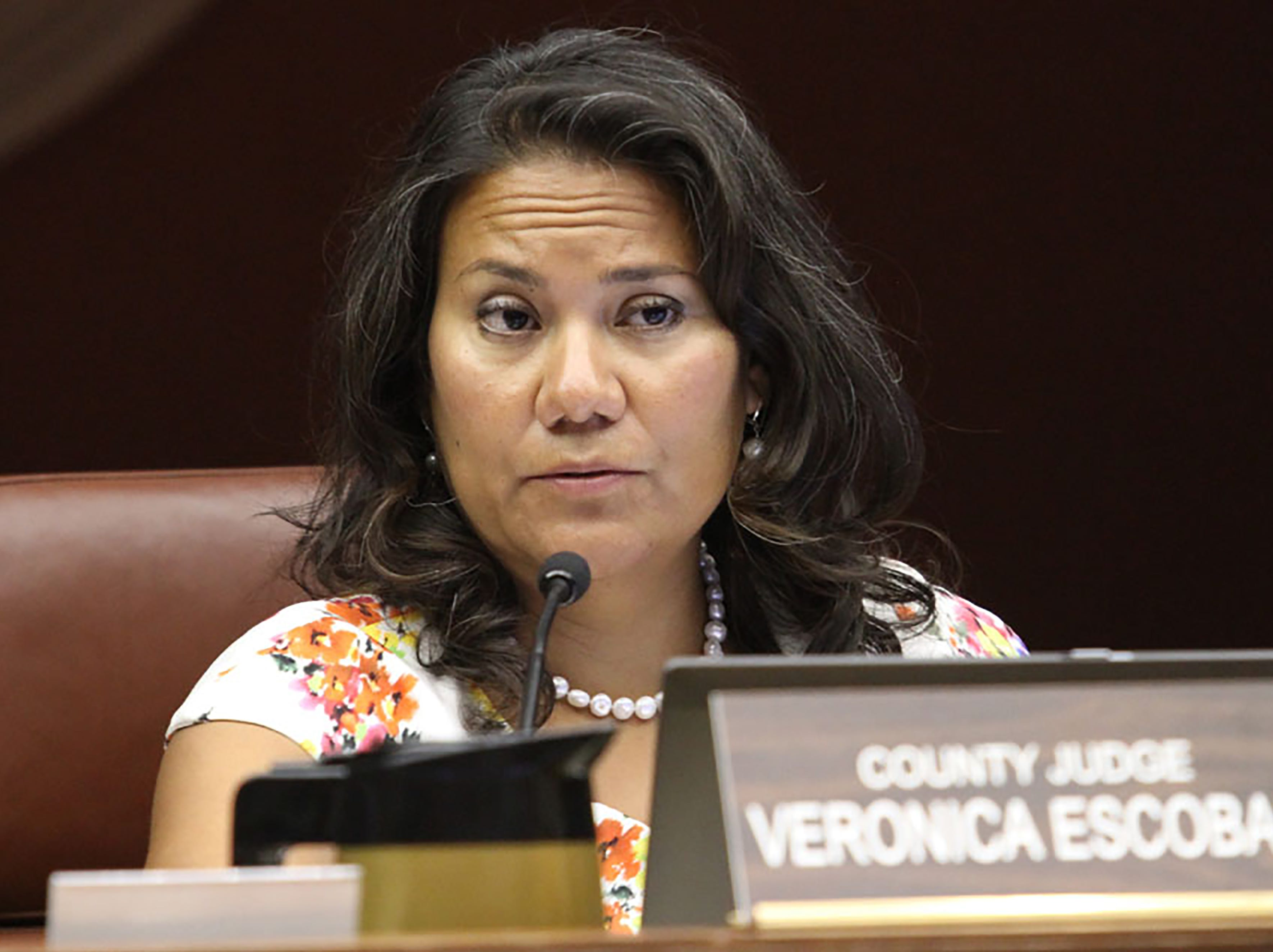 County Judge Veronica addresses a speaker during commissioners court.