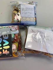 "Cumberland Christian School 10th graders made ""chemo"" snack bags as part of the school's breast cancer awareness activities. The bags will be distributed to patients at a local hospital."