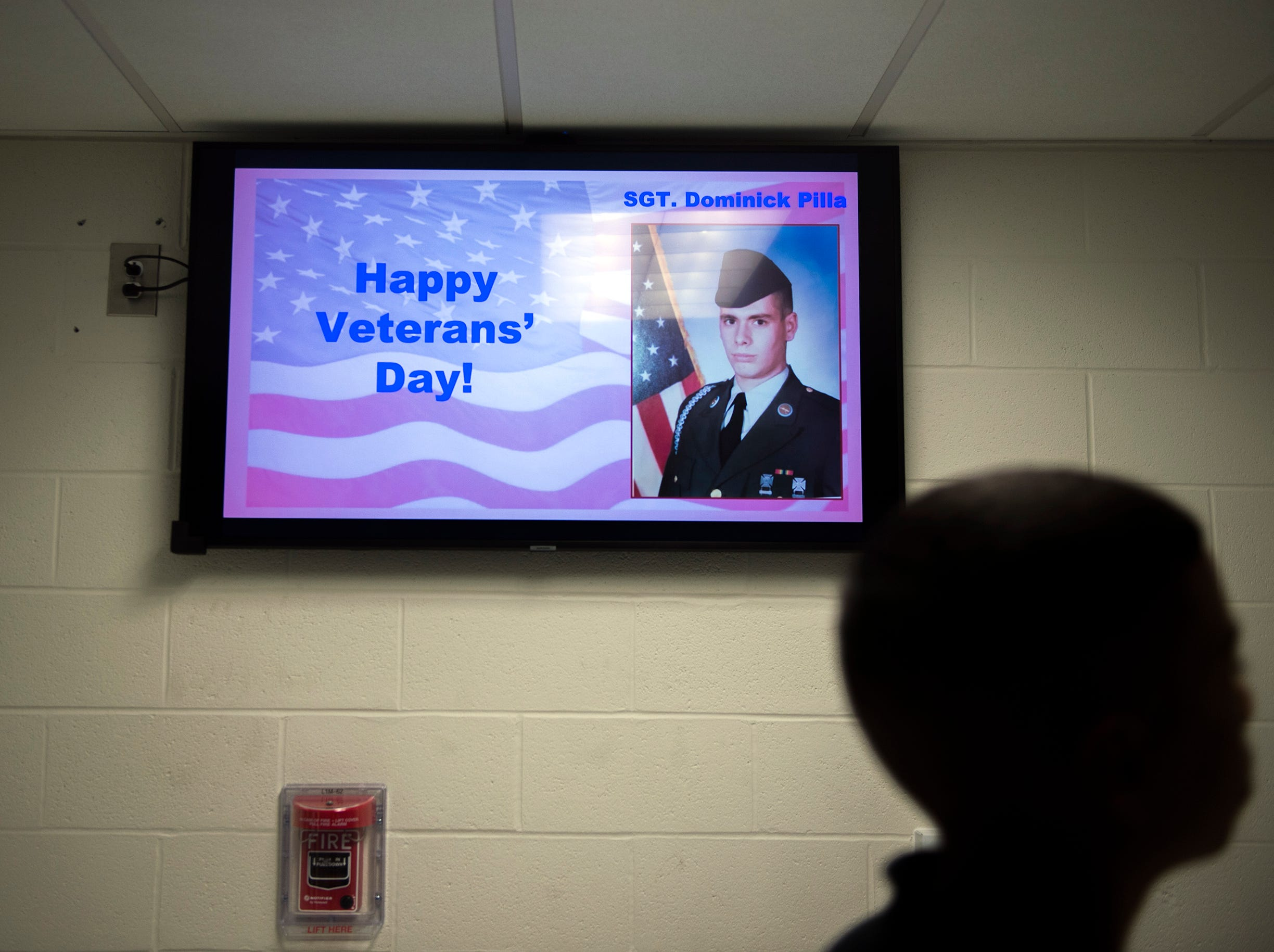 A television screen in the hallway honors Veterans Day with an image of Sgt. Dominick Pilla Monday, Nov. 5, 2018 at Lincoln Avenue School in Vineland, N.J.