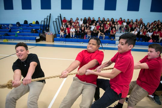 Students play a four-way military themed game of tug of war Monday, Nov. 5, 2018 at Lincoln Avenue School in Vineland, N.J.