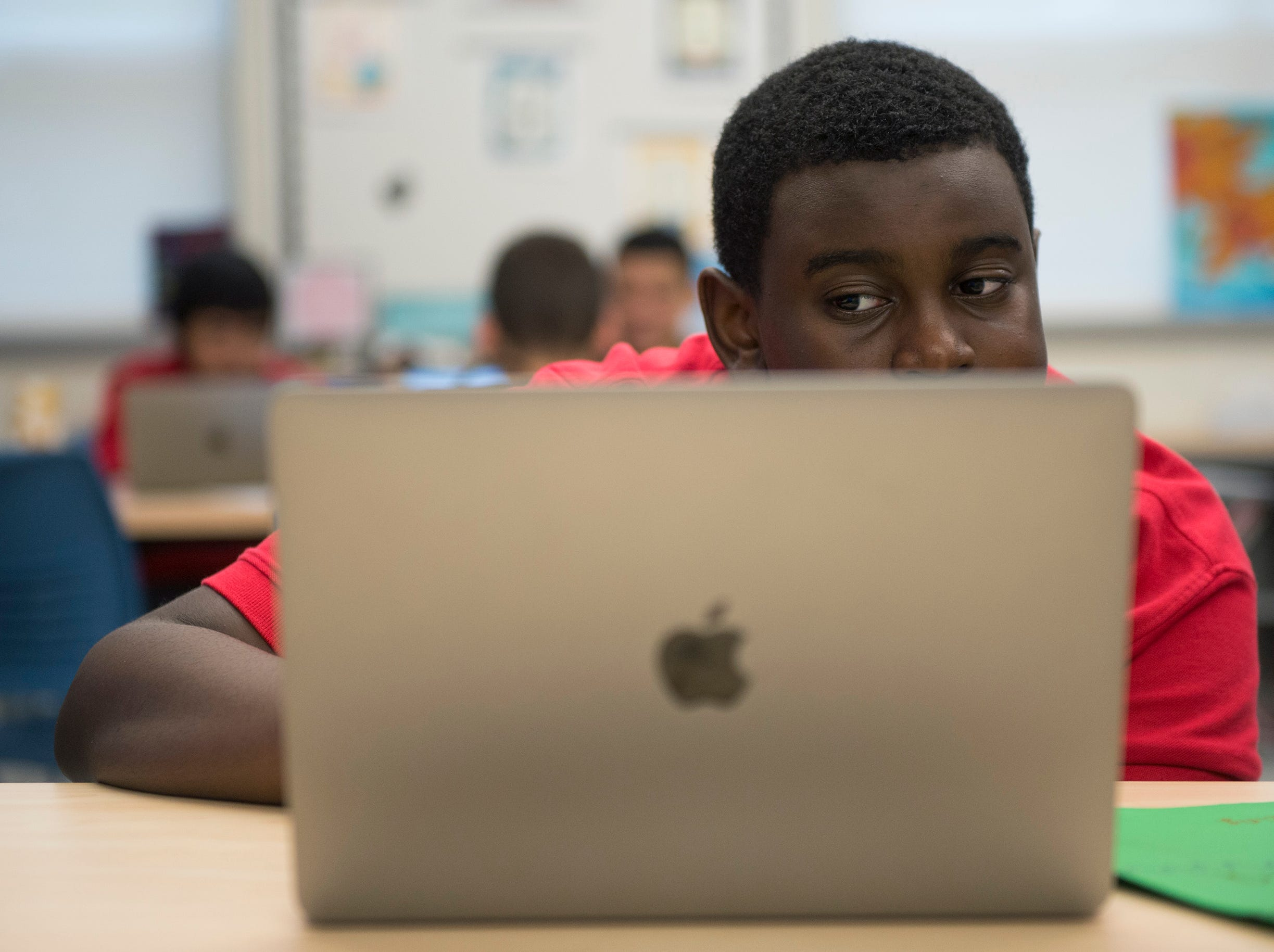 Theo Barclay, 14, works on his Veterans Day project Monday, Nov. 5, 2018 at Lincoln Avenue School in Vineland, N.J. Barclay's father is in the army and currently deployed.