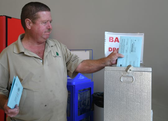 Eager voters cast their ballots on Nov. 5 at the Tulare County Elections Office.