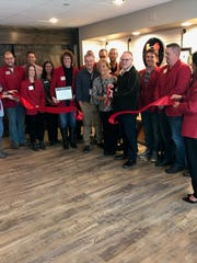 The ribbon cutting from the grand opening of The Blind Rooster Kitchen & Bar on Friday inside the Central Wisconsin Airport's new restaurant.