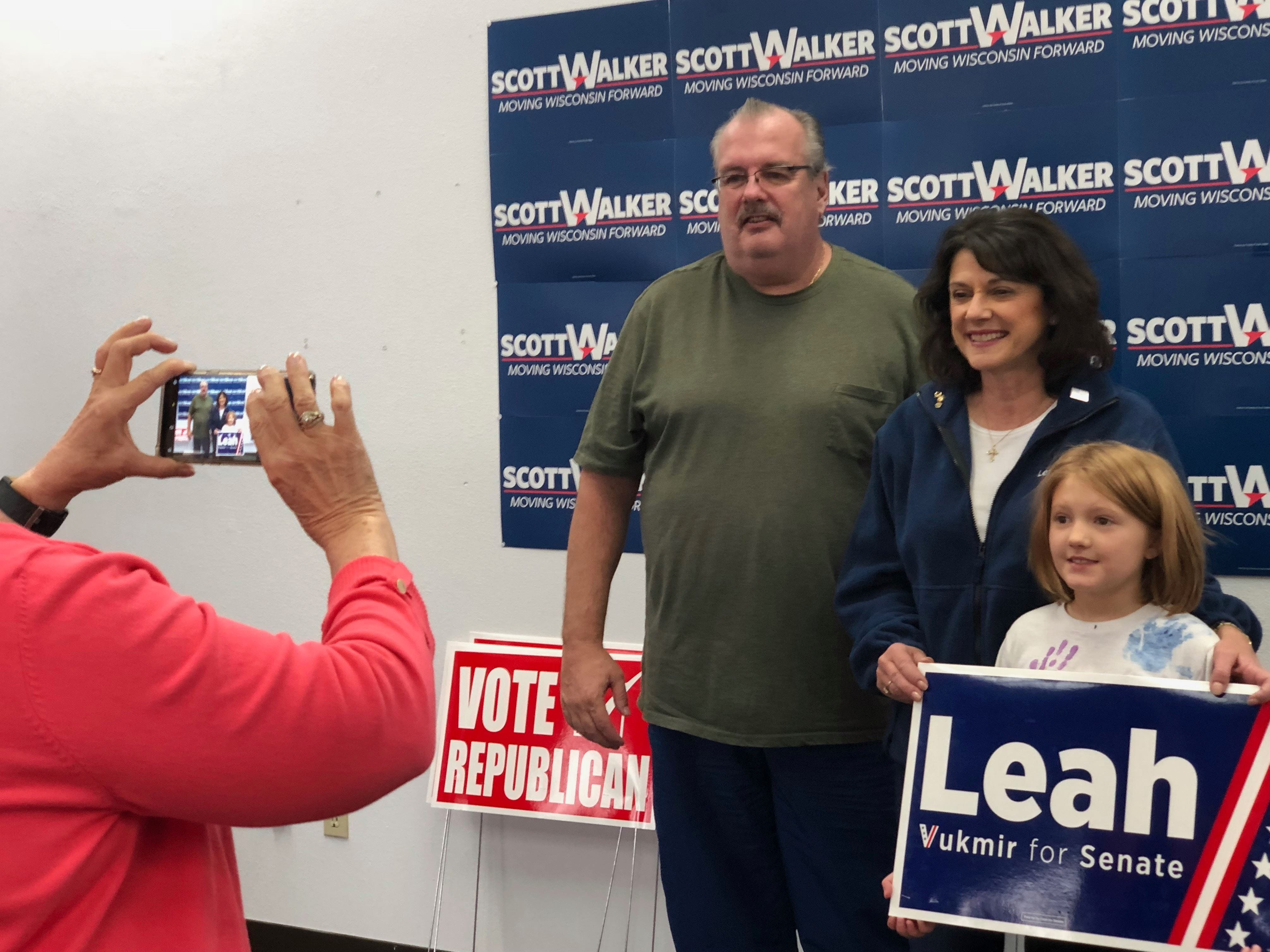 U.S. Senate candidate Leah Vukmir poses with supporters Nov. 5, 2018, at the Marathon County Republican Campaign Headquarters in Weston.