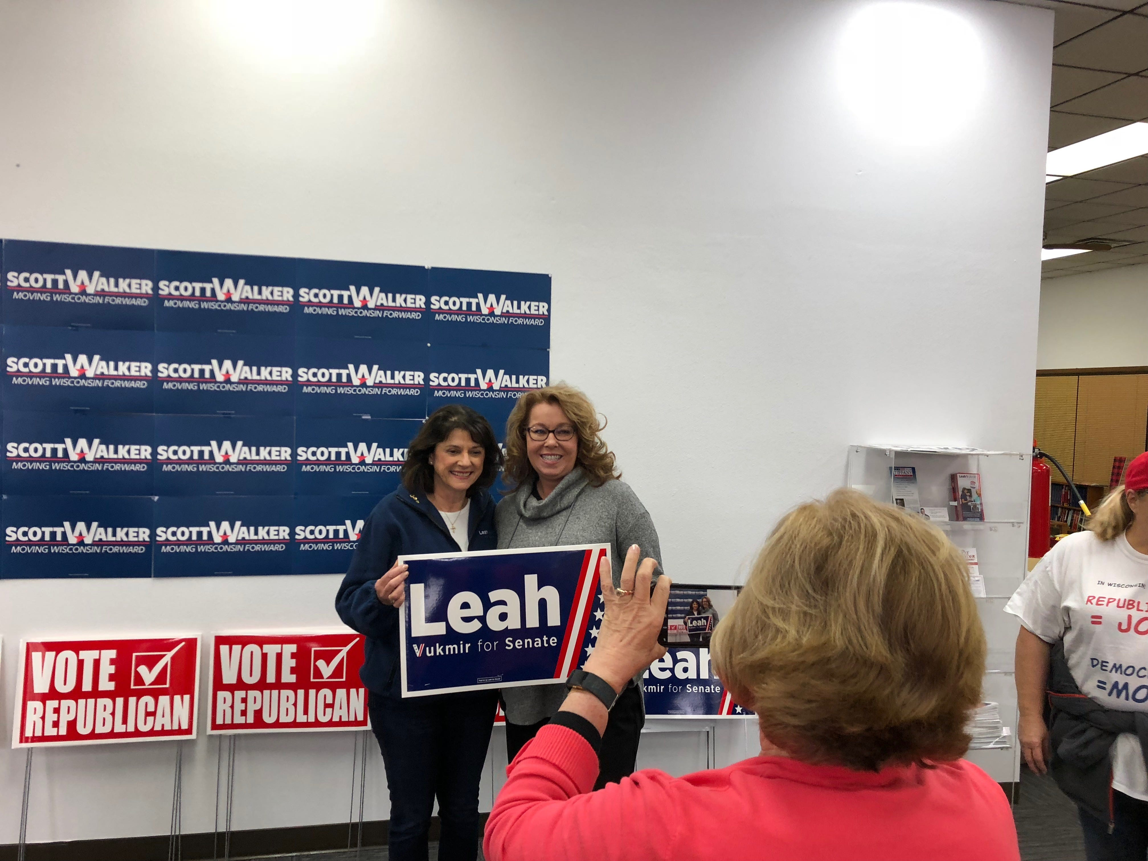 U.S. Senate hopeful Leah Vukmir poses for photos with supporters in Weston on Nov. 5, 2018, during her final home stretch of campaign visits.