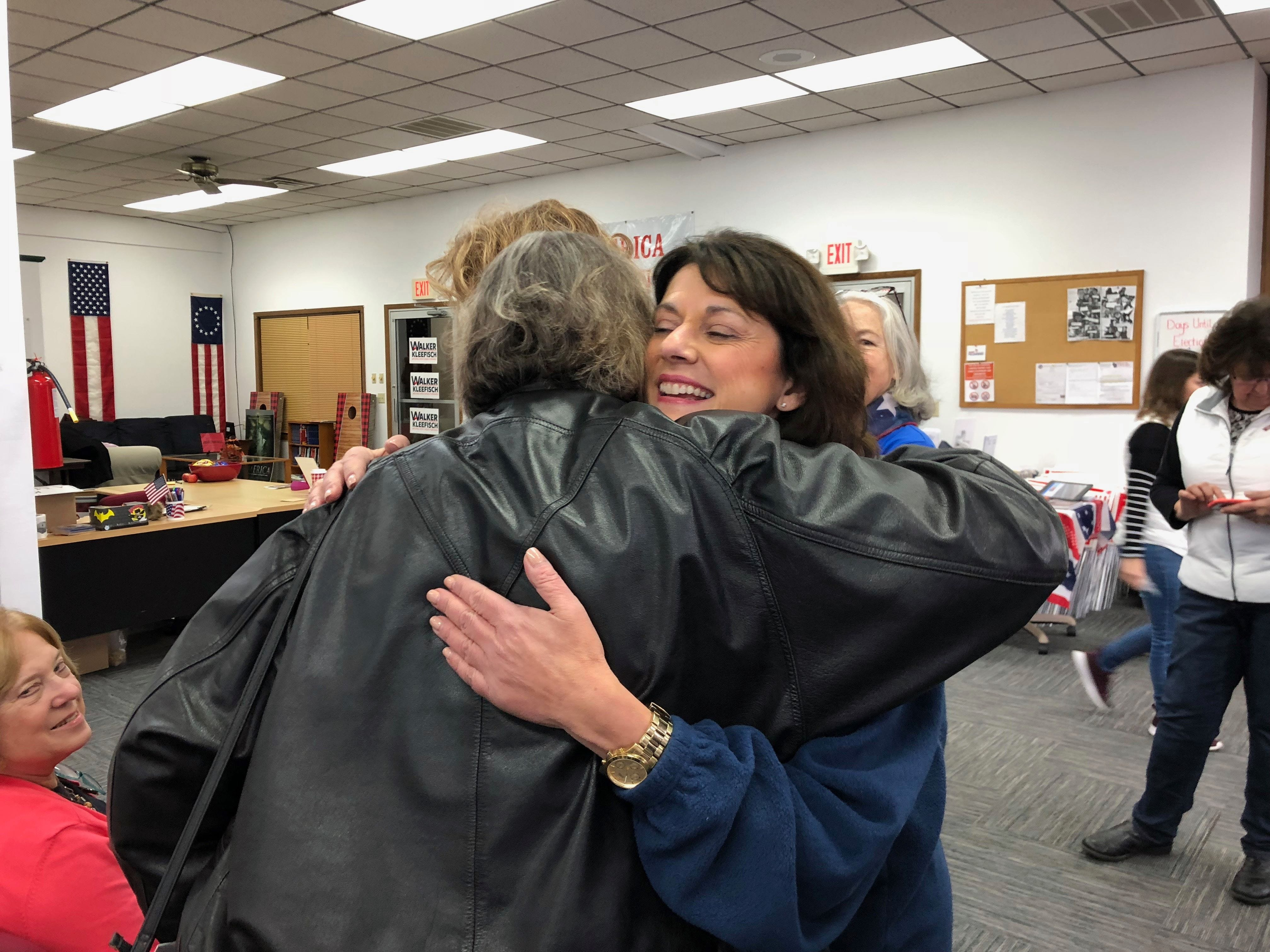 Republican candidate for U.S. Senate Leah Vukmir embraces a supporter at the Marathon County Republican Campaign Headquarters on Nov. 5, 2018, during her final day of campaigning.