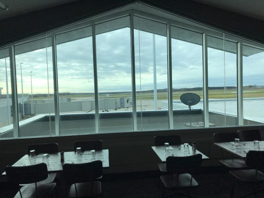 A big window overlooking the runways of the Central Wisconsin Airport inside its new restaurant The Blind Rooster Kitchen & Bar.