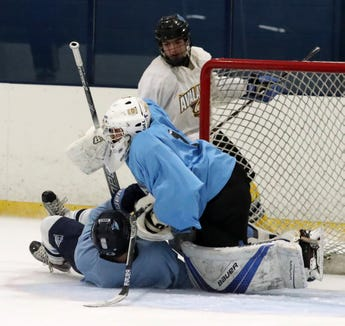 Suffern hockey players collide during their first practice of the season at Sport-O-Rama in Monsey Nov. 5, 2018.