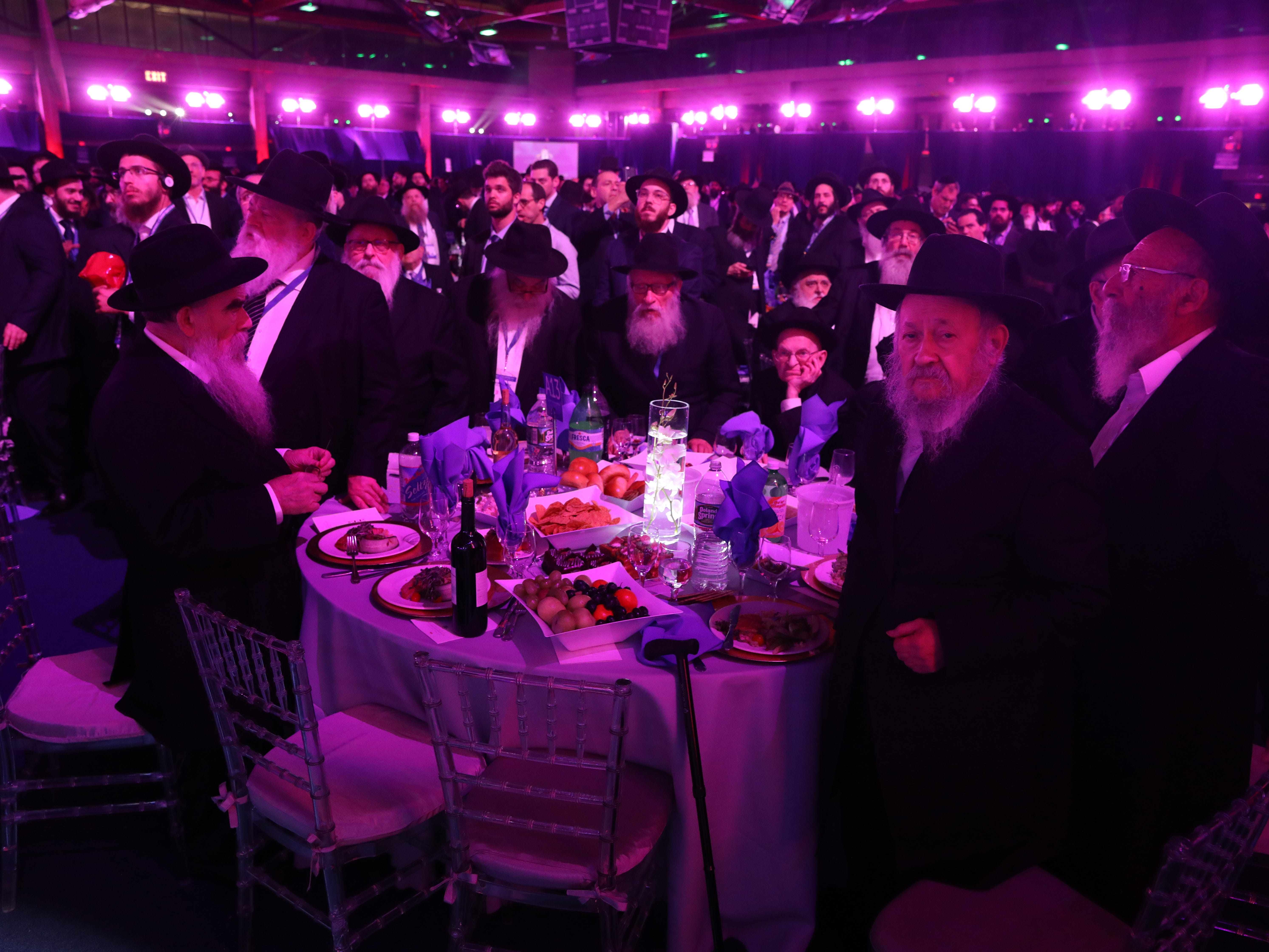 Rabbis attend a banquet at Rockland Community College on Sunday in Suffern. They are among 5,600 rabbis and guests from 100 countries in New York for the International Conference of Chabad-Lubavitch Emissaries, an annual event aimed at strengthening Jewish awareness and practice around the world. This year's gathering comes a week after the anti-Semitic shooting in Pittsburgh, which was a focal point of the conference.