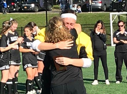 Hackley coach Jenny Leffler hugs goalieJenny Canoni, who had 31 saves.