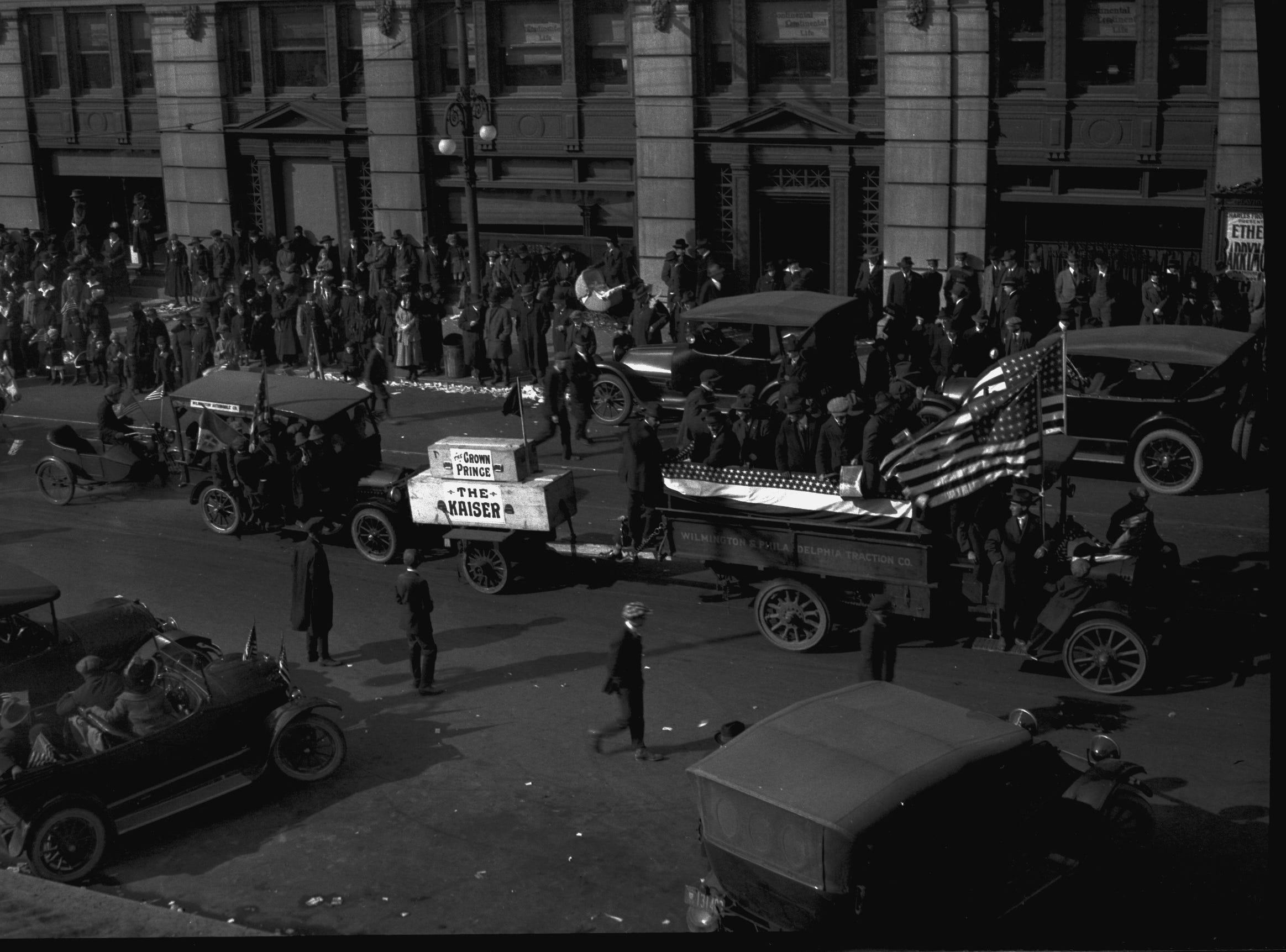 """A large casket marked """"The Kaiser"""" topped with a smaller one marked """"Crown Prince"""" in the Wilmington Peace Parade after Armistice Day in 1918."""