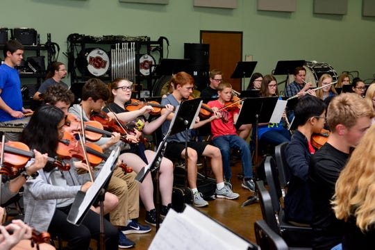 The 60-member Youth Symphonic Orchestra rehearses for a first time-ever concert with the MSU Wind Ensemble and Chamber Orchestra at 1:30 and 4 p.m. Sunday for a program to honor Veteran's Day.