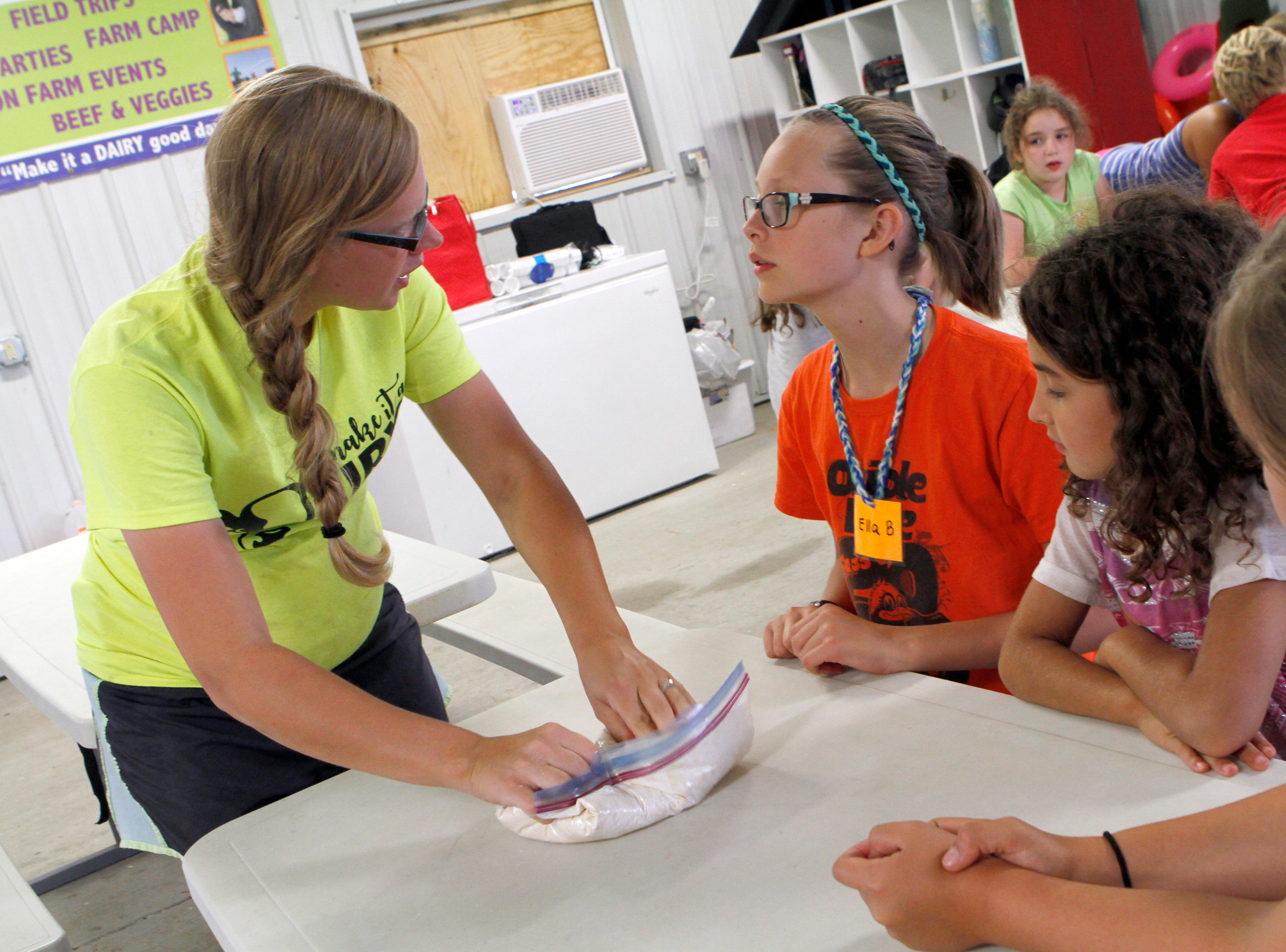 Jacki Moegenburg, of Roden Barnyard Adventures, LLC, kneads dough for pretzels during a summer farm camp on Aug. 9.
