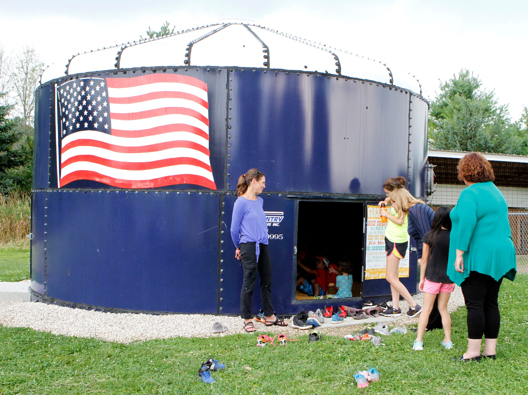 A miniature Harvestor silo serves as a large corn pit for campers at Roden Barnyard Adventures farm camps.