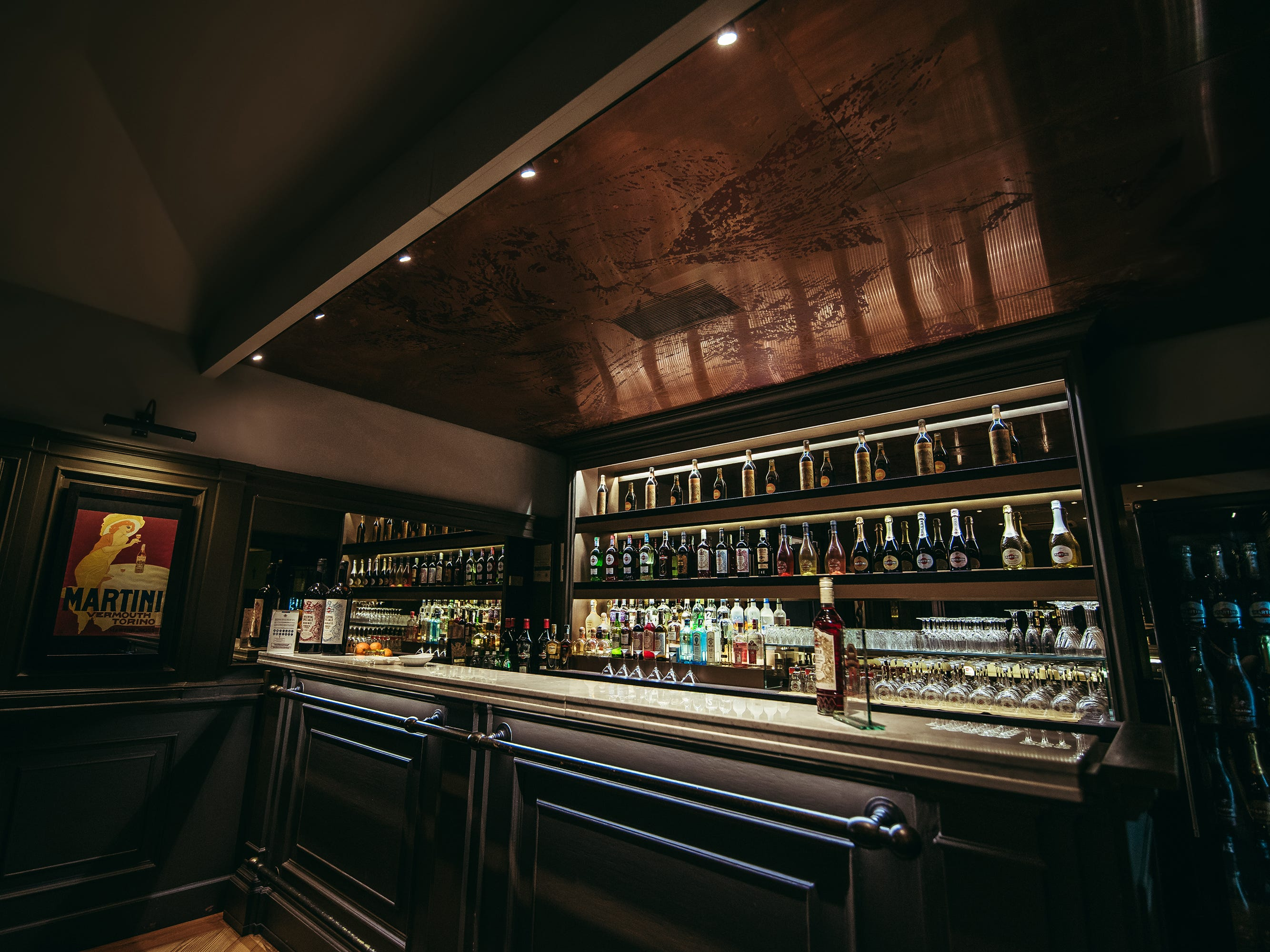 The visitors center boasts a number of event spaces, including a loaded back-room bar stocked with the full Martini portfolio, as well as brand siblings from Bacardi.
