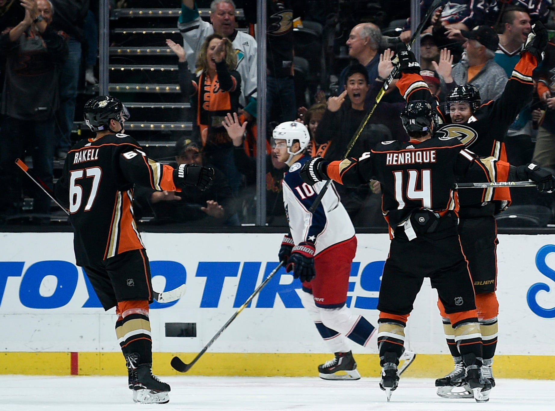 Nov. 4: Anaheim Ducks defenseman Cam Fowler (4) celebrates his game-winning goal with center Adam Henrique (14) during overtime against the Columbus Blue Jackets at Honda Center.