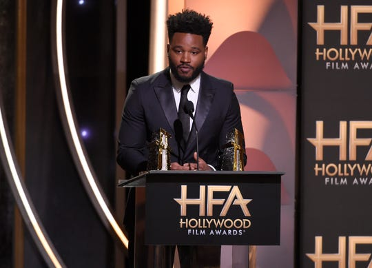 "Director Ryan Coogler accepts the Hollywood Film Award for ""Black Panther."""