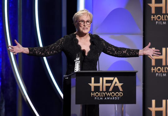 """Glenn Close accepts the Hollywood actress award for """"The Wife"""" at the Hollywood Film Awards."""