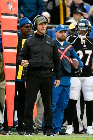 Baltimore Ravens head coach John Harbaugh stands on the sidelines during the fourth quarter against the Pittsburgh Steelers at M&T Bank Stadium.