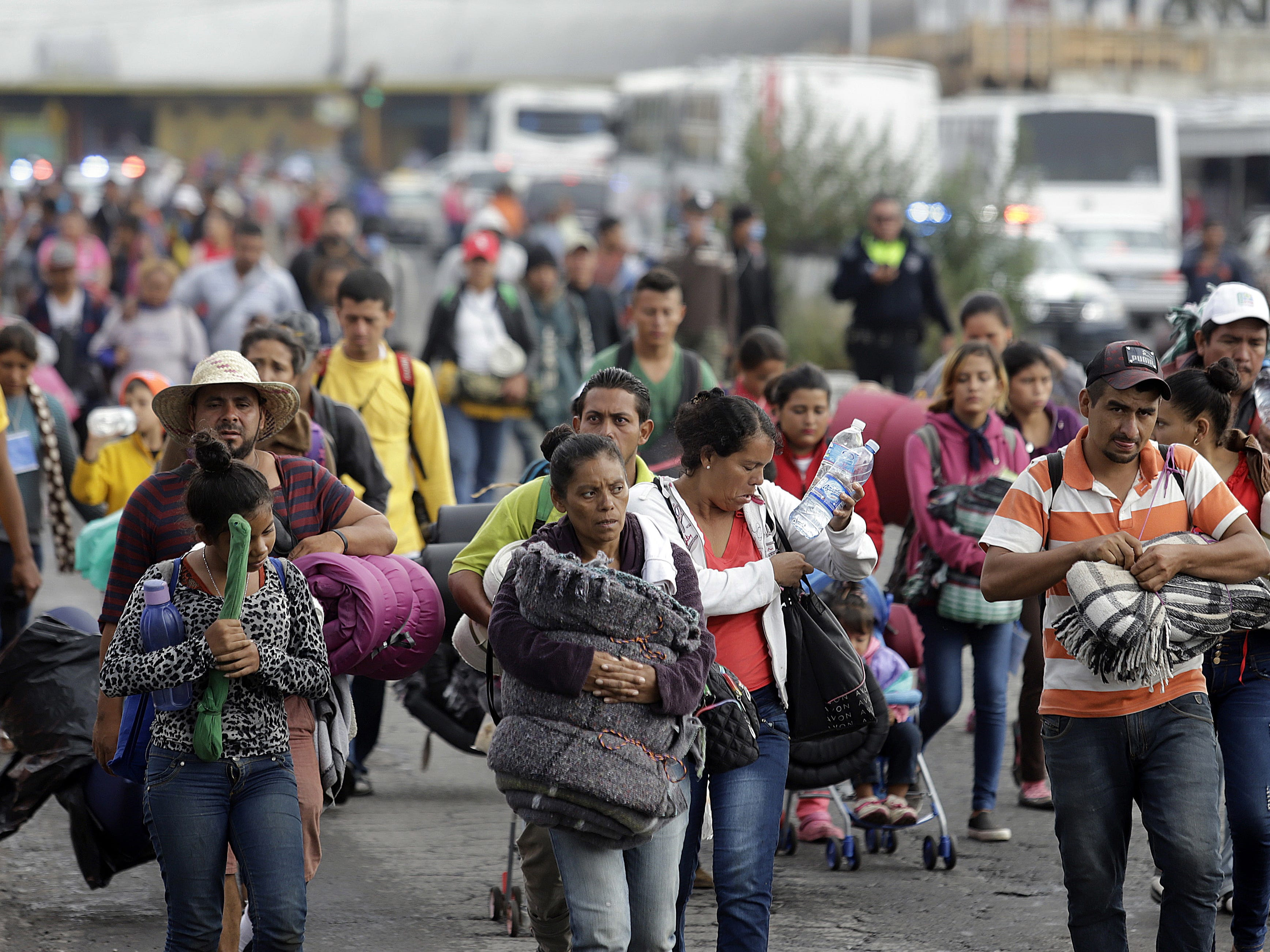 Members of the migrant caravan arrive at the shelter of the Church of the Assumption, in the city of Puebla, in Puebla state, Mexico, Nov. 4, 2018.