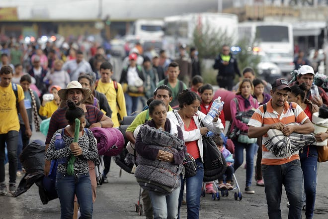 Members of the immigrant caravan arrive at the shelter of the Church of the Assumption in the city of Puebla in Puebla state, Mexico, on Nov. 4.