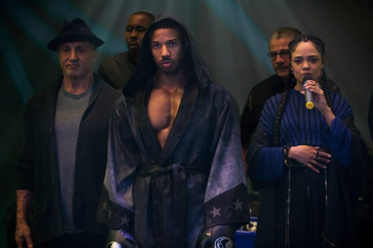 """Michael B. Jordan's chest muscles indeed look defined as he stands with Sylvester Stallone (as Rocky) and Tessa Thompson (Bianca) in """"Creed II."""""""
