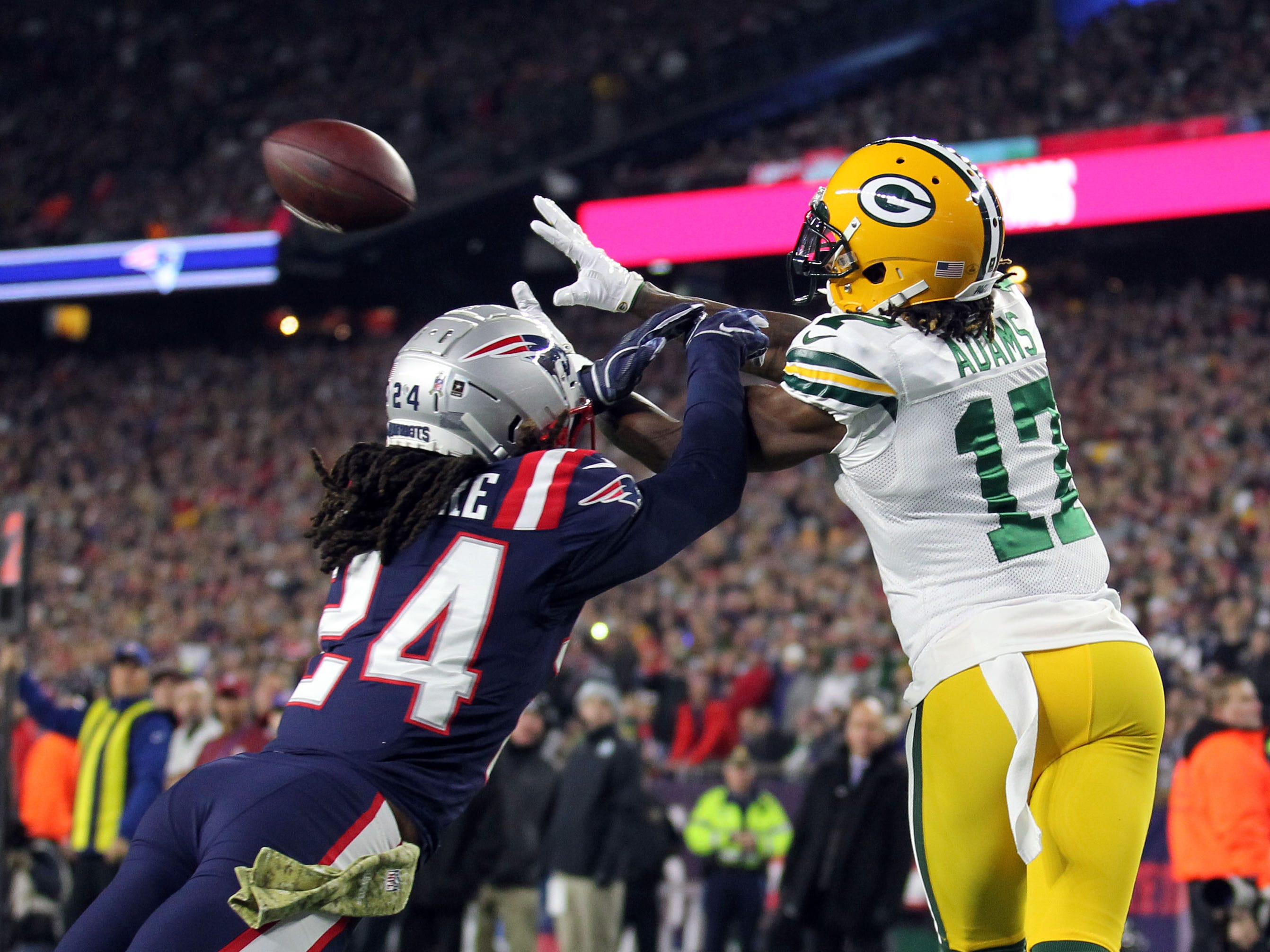 New England Patriots cornerback Stephon Gilmore breaks up a pass to Green Bay Packers wide receiver Davante Adams during the first quarter at Gillette Stadium.