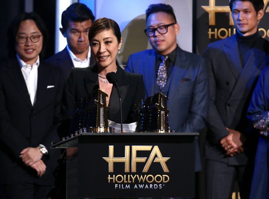 "Michelle Yeoh speaks at the Hollywood Film Awards with the ""Crazy Rich Asians"" cast (from left) Jimmy O. Yang, Ronny Chieng, Nico Santos and Harry Shum Jr."
