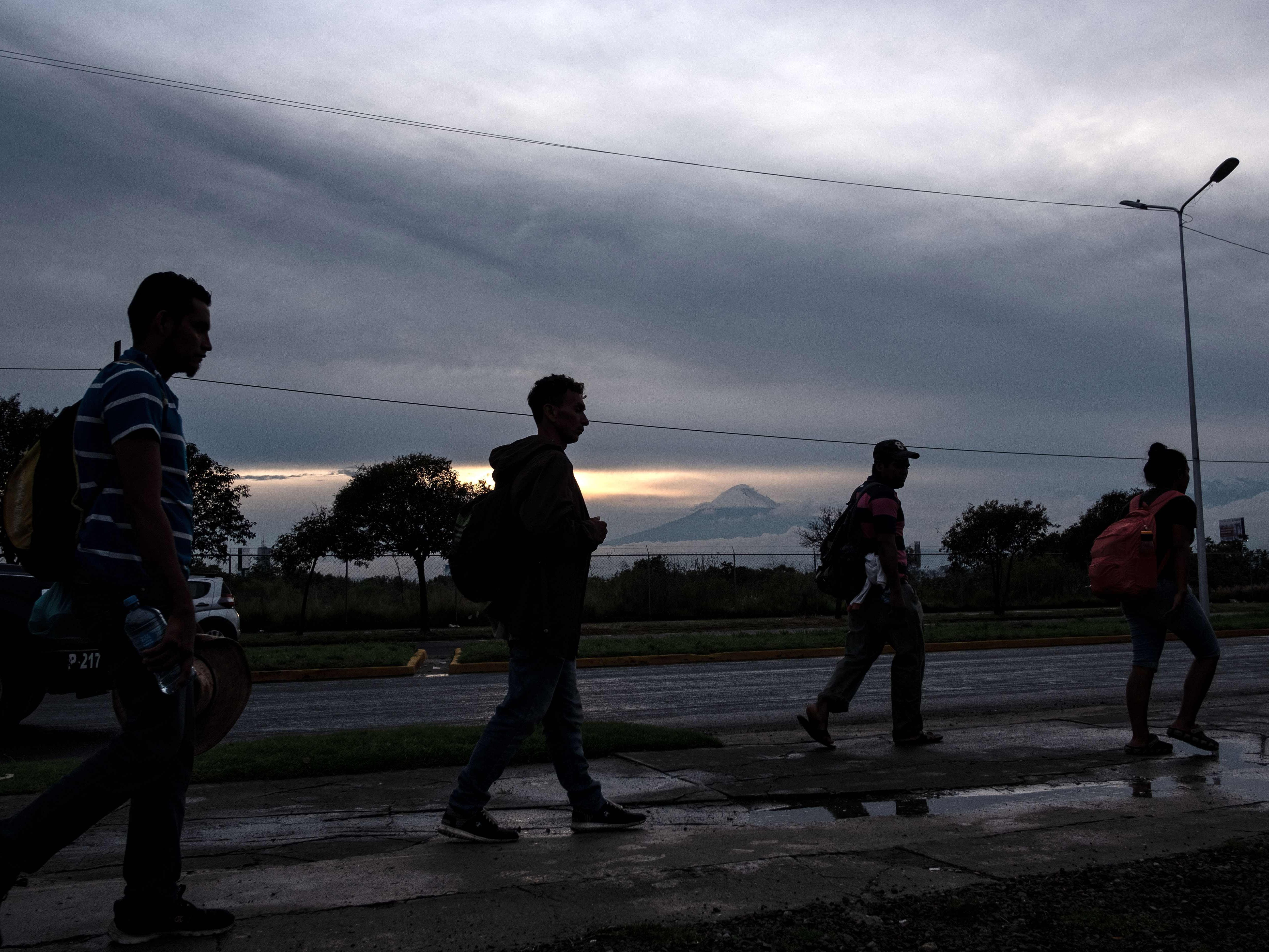 Central American migrants continue moving towards the United States in hopes of a better life or to escape violence, head to a shelter after arriving in Puebla, Mexico, on Nov. 4, 2018.