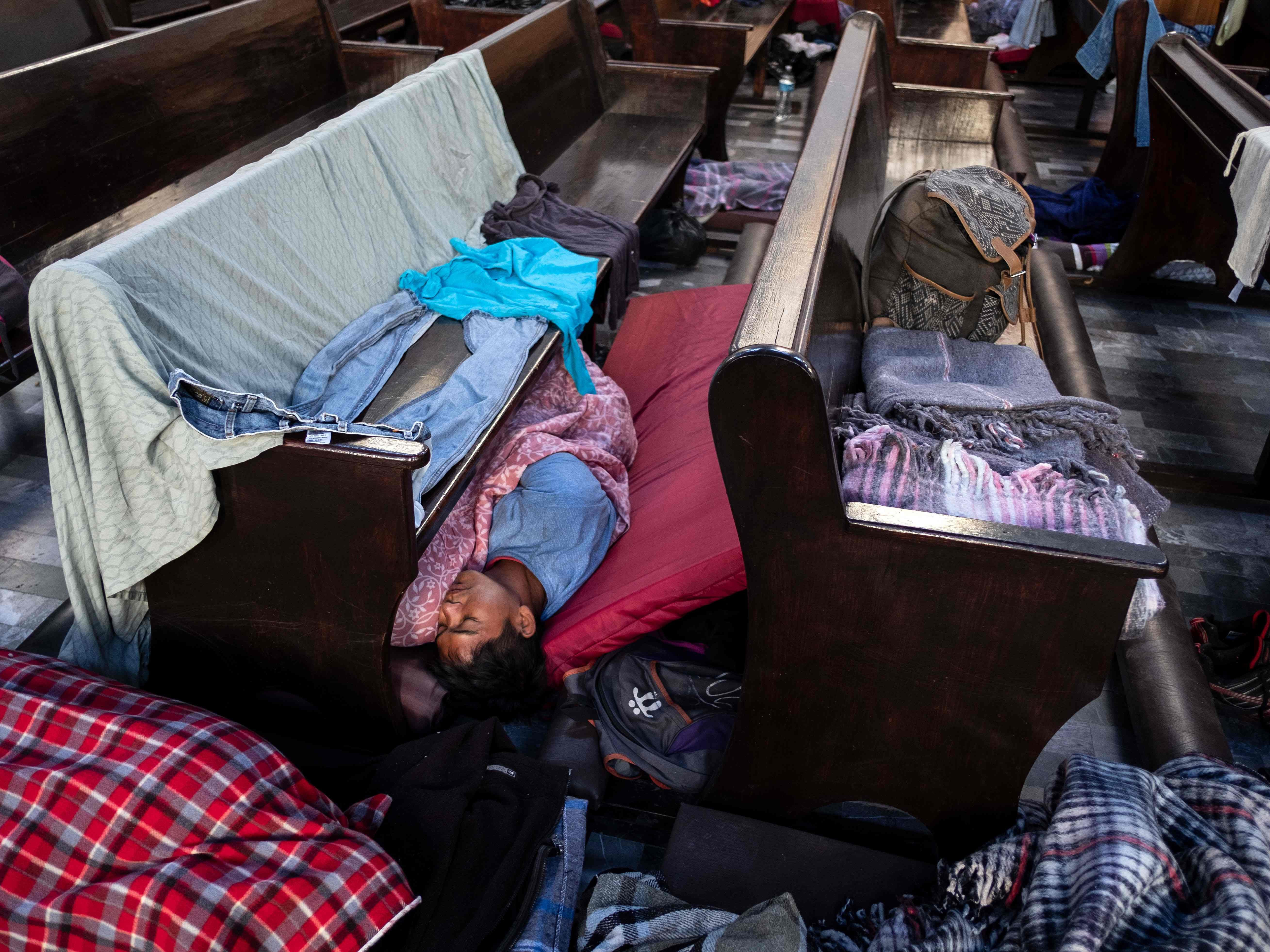 Migrants -mostly Hondurans- taking part in a caravan heading to the US, rest at the Asuncion temple -fitted out as a temporary shelter- in Puebla, Puebla state, Mexico, on Nov. 4, 2018.